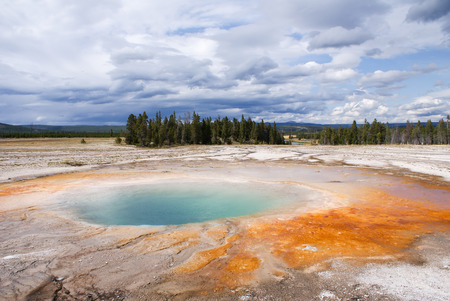 Yellowstone National Park Grand Prismatic Spring color cloudy weather Stock Photo