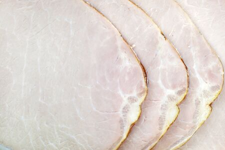 Piece of ham sausage  top view background Stock Photo