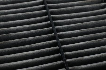 Cabin car with a dirty carbon air filter,spare part on a white background