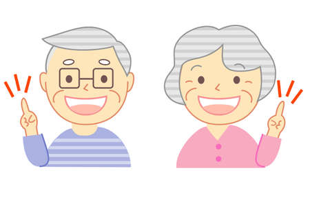 Elderly couple pointing with a smile