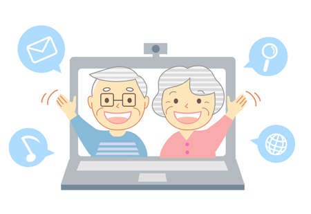 Elderly people with smiles talking through a computer