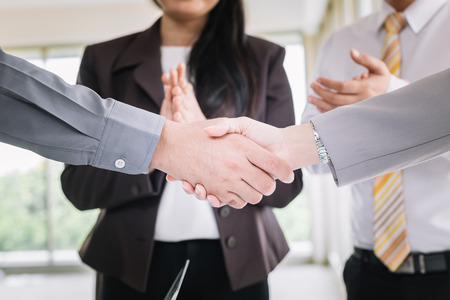 Businessmen shake hands after meeting.Business etiquette to congratulate mergers and acquisitions. Stock Photo