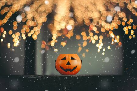Jack O' Lanterns orange pumpkin with eyes and smiles placed on a black background, Halloween holiday. Stok Fotoğraf