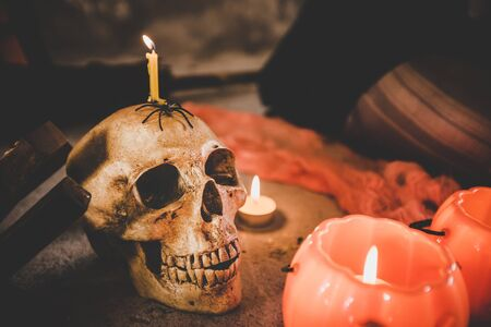 Halloween pumpkin with ghost skull and candle with black background. Stok Fotoğraf