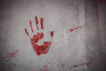 Nightmares of scary fear at the halloween festival. Bloody hands placed on a solid wall, Horror and terror.