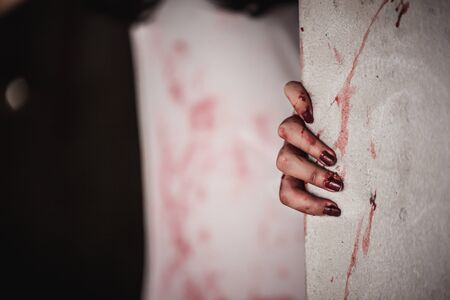 Bloody hands in the dark, Close up hand that feels painful and lonely with suffer from depression. Horror theme. Stock Photo