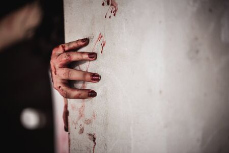 Bloody hands in the dark, Close up hand that feels painful and lonely with suffer from depression. Horror theme.