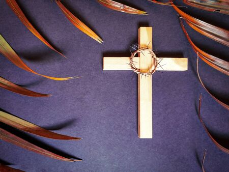 Lent Season,Holy Week and Good Friday concepts - photo of wooden cross, crown of thorns and palm leave in vintage background Фото со стока