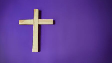 Lent Season,Holy Week and Good Friday concepts - image of wooden religious cross in purple vintage background