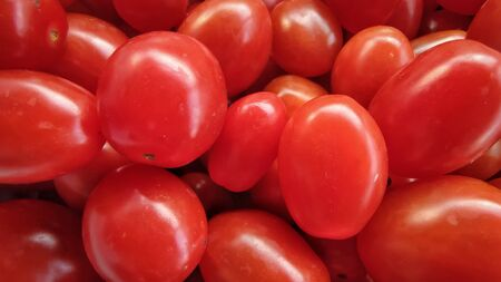 Background of cherry plum tomatoes in vintage style