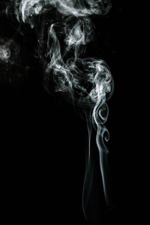 White puffed smoke in a dark background