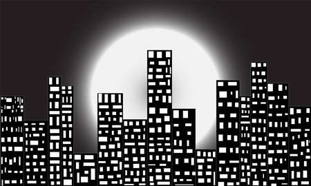 It is a picture of a busy city at dark night, beautified by only electric light and moon. Stock Photo