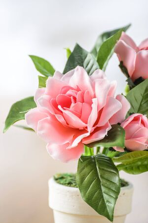 Bunch of artificial flowers on wood background