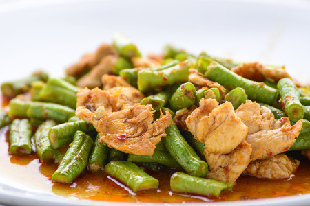 long bean: fried Yard Long bean with red curry paste and pork Stock Photo