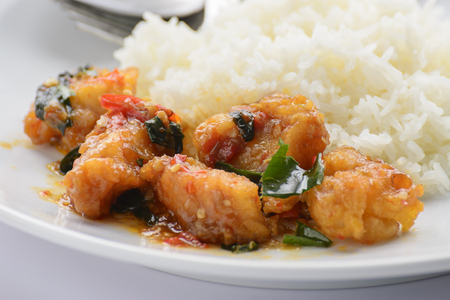 chilli sauce: Fried fish with chilli sauce and cooked rice