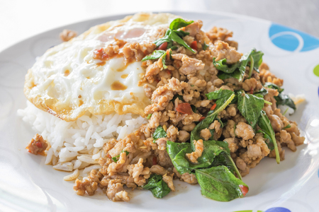 Thai spicy food, Spicy fried pork with basil and fried egg