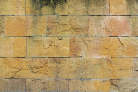 yelllow: Old yellow stone wall background