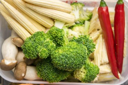 baby corn: Fresh broccoli baby corn Pleurotus eryngii and chilli in plastic box
