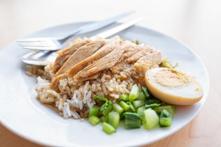 Stewed pork leg on rice with egg