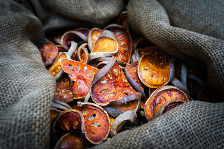 Slices of dry bael fruit in sack Stockfoto