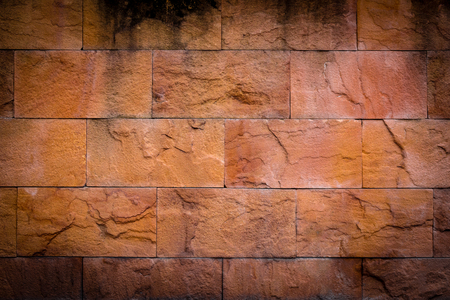 Old yellow stone wall background