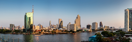Bangkok,Thailand February 28,2019 : City scape view of Chao Phraya River in the evening,Panorama.