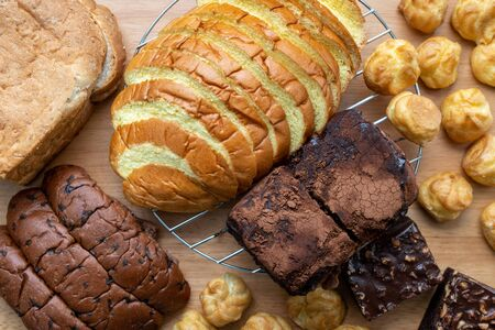 Close up of many kind of bakery on wooden background