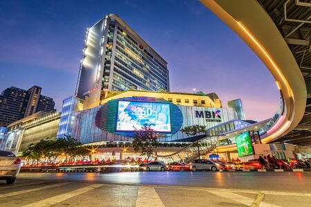 Bangkok, Thailand-January 2, 2020: Lighting of MBK Shopping Center, famous shopping mall in Bangkok, Thailand at twilight.