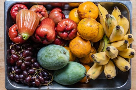 Many kind of Thai fruits on stainless steel tray, top view Stockfoto