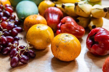 Many kind of fruit on wooden background Stockfoto