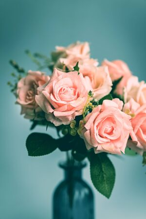 Close up of  pink rose bouquet in a vase