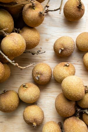 Top view close up of longan on wooden background  Stockfoto