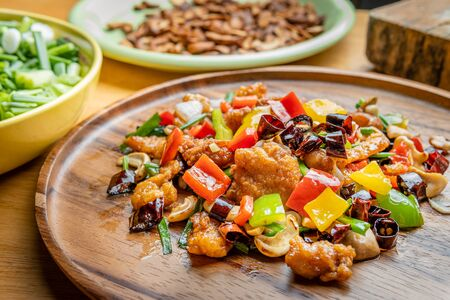 Stir fried Chicken with cashew nuts on wooden plate