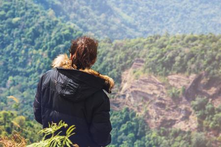 soft peak: Retro vintage soft focus young woman traveler looking at mountain peak