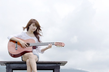 nylon string: Thai cute girl with nylon string guitar Stock Photo
