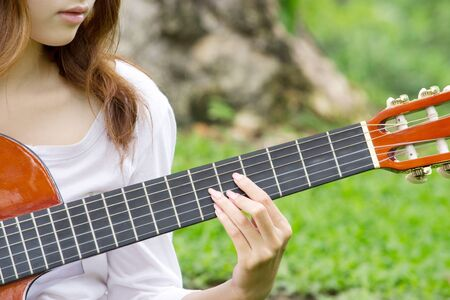 nylon string: Thai cute girl with nylon string guitar in the garden