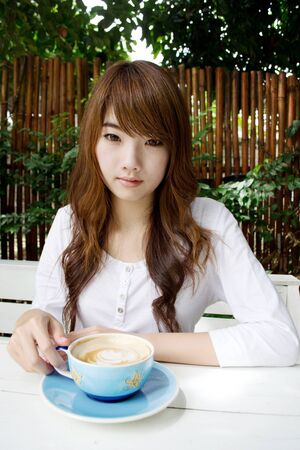 comely: Asian pretty girl drink latte02
