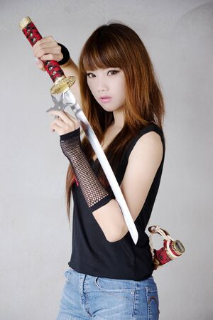 woman with sword: Beauty assassin Stock Photo