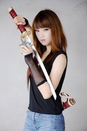 female assassin: Beauty assassin Stock Photo