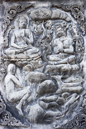You can see the story of Buddhist carvings on the wall of the temple in Thailand.