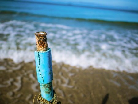 Close up Vintage Water Depth Marker on the beach with endless horizon,Summer vacation on the beach,Summer concept 版權商用圖片