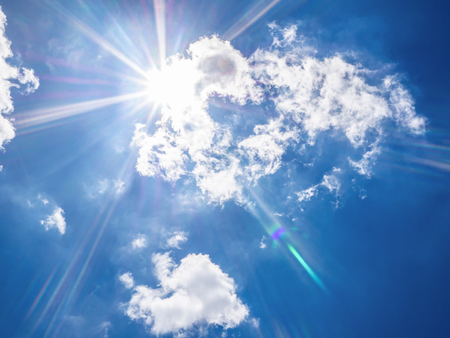 Amazing Idyllic Blue sky background and sun ray with white cloud,cloudscape concept