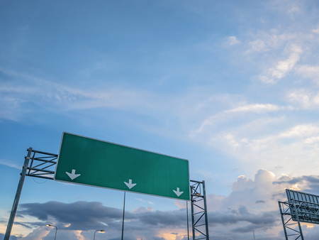 Big Traffic guide post on top of the road with idyllic sky and white cloud in the city,mock up Foto de archivo