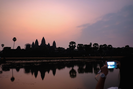 silhouette ankor wat in the dark with beautiful sunrise sky,siem reap,cambodia
