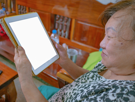 Old asian women very happy Look at the tablet,Mock up Stock Photo