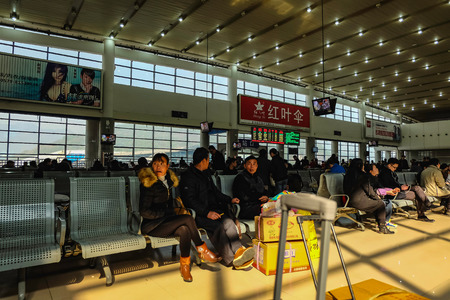 yiwuChina - January 24 2015: Chinese people wait for the rocket train to go to another city in Yiwu Train station,yiwu city zhejiang china