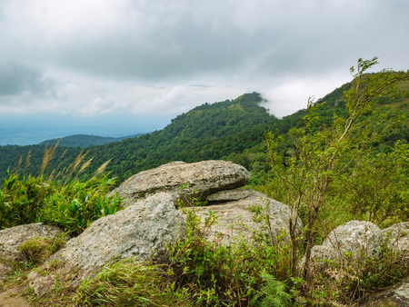Stone cliff and cloud sky view on Khao Luang mountain in Ramkhamhaeng National Park,Sukhothai province Thailand Imagens
