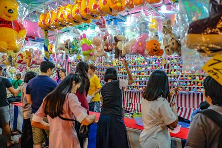 Bangkok/Thailand - 24 November 2015:Unacquainted Thailand people or tourist Playing thai Local Street Shooting Game  in