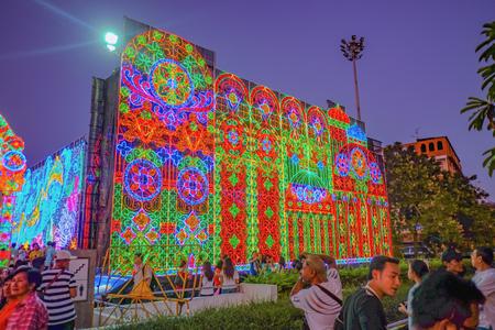 Bangkok/Thailand - 1 January 2016: Light decor of Bangkok Metropolis at New Year light show case in Bangkok with People Come to See the light.Bangkok governor Sukhumbhand Paribatra was alleged corruption 39 million baht. Редакционное