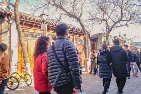 Beijing/China - 24 February 2017:Unacquainted Chinese people or tourist walking in  Nanlouguxiang the Old Part area of the Beijing city centre